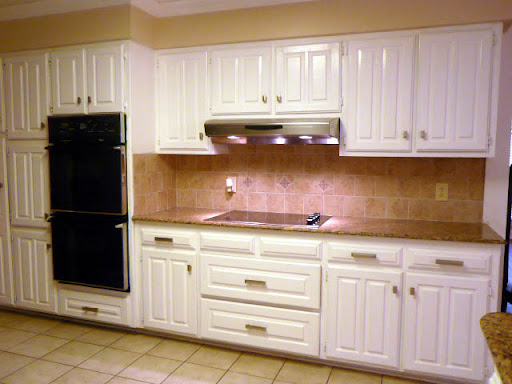 Kitchen - Double Oven. Smoothtop Range. Granite Countertops and Tiled Backsplash.  Cermic Tiled Floors