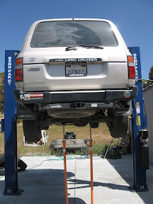 Mike's hydraulic lift out at his shop in Ramona makes jobs as this much easier.