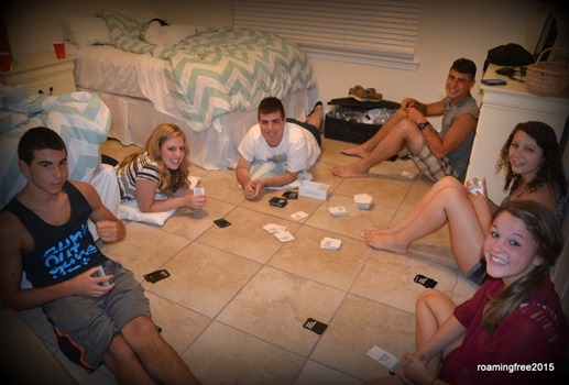 Teens playing cards