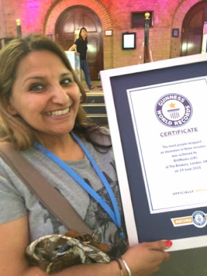 Holding the official Guinness World Records certificate
