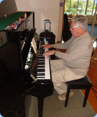 Jim Nicholson playing the Wertheim piano. Photo courtesy of Delyse Whorwood.