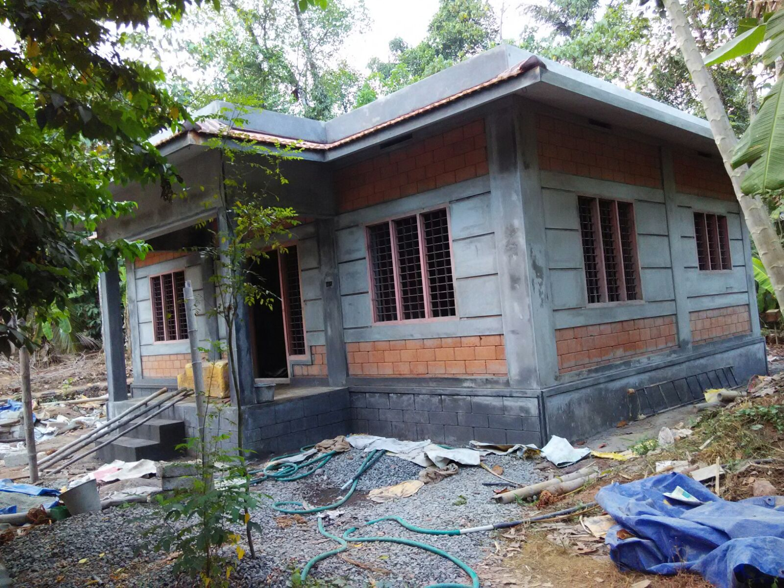 low cost house construction at pampadi building designers