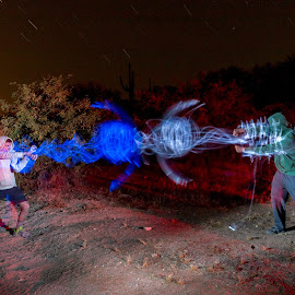 Brothers by Adrian Ramirez - Abstract Light Painting ( flash, desert, light painting, blue, white, star trails )