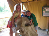 Hannah and Bryan standing on an elephant skull at the Nashville Zoo 09032011
