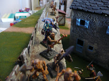 Carmilla directs the battle for the northwest wal from the rear, forcing allies off the wall with her Skull of Terror.