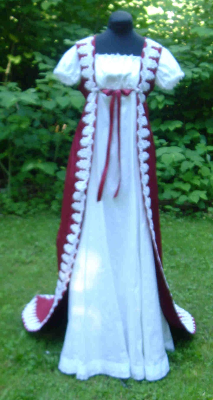 gown is made of white silk