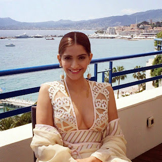 Sonam Kapoor wears Skin Colored Transparent Deep Neck Gown at Cannes 2015 Film Festival