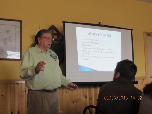 Jim Miller teaching beginning beekeeping class 2013.JPG