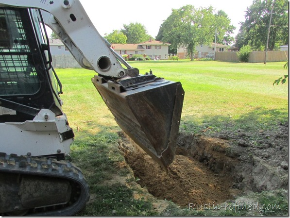 Using a bobcat to help save time with a backyard diy project