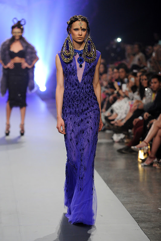 A model walks the runway at the Amato By Furne One show during Fashion Forward at Madinat Jumeirah on April 13, 2014 in Dubai, United Arab Emirates.