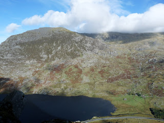Pen Yr Ole Wen just escapes the cloud. Carnedd Dafydd is obscured