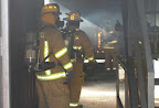 Chief Wyatt inspecting the burn prior to trainees entering the building