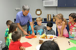 Montessori elementary offers a strong academic program, but goes much beyond that. Here, students learn how to properly use sharp knives to cut up fruit and vegetables for their daily snack. Practical life skills are integrated into the curriculum!