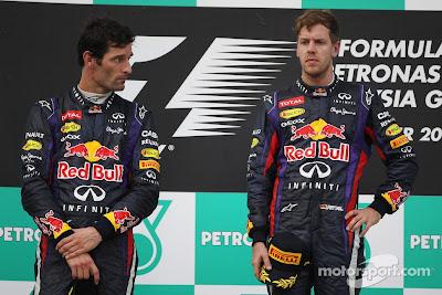 Марк Уэббер и Себастьян Феттель на подиуме Гран-при Малайзии 2013