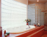 """Cory Master Bath - The master bath features a """"walk-in"""" glass block shower and a dramatic glass block wall by the jacuzzi tub. Extensive use of ceramic tiles complement the design."""