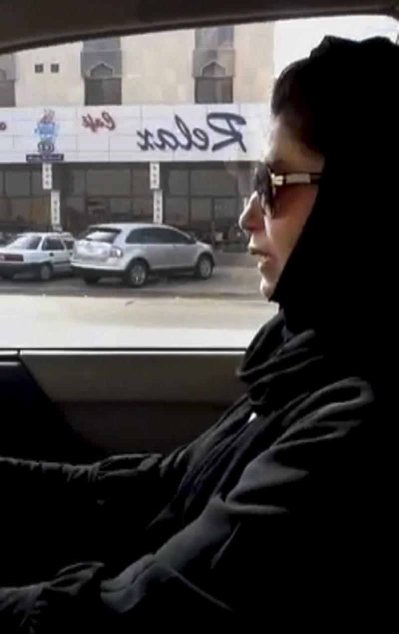 Al-Shamasi drives a car as