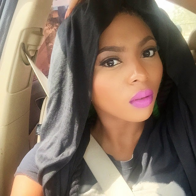Stephanie Coker Just flaunting her lipstick