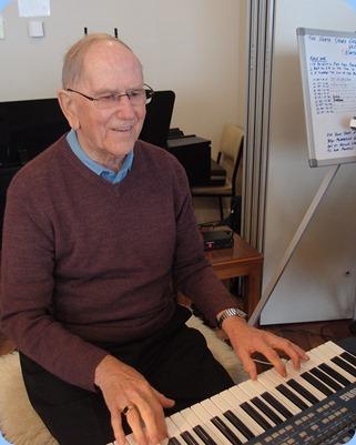 John Beales playing his Korg Pa500. Photo courtesy of Dennis Lyons.