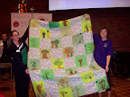 2015 Convention Beth McKinley Lutheran World Relief receives a quilt made by third graders at Chapel School Bronxville.jpg