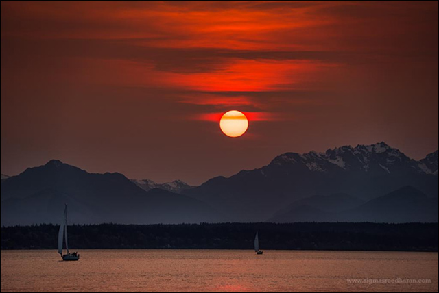 Sunset over Puget Sound and the Olympic Mountains on 18 April 2015. The red color is caused by smoke from massive wildfires burning a large area in Siberia. Photo: Sigma Sreedharan Photography