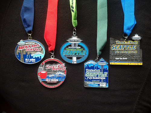 all five Rock 'n' Roll Seattle Half Marathon medals