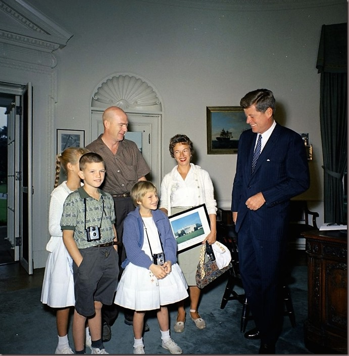 JFK gretting the millionth visit to the White House