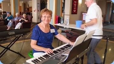 Diane Lyons setting-up to play on her Korg Pa900. Photo courtesy of Dennis Lyons.