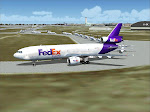 FedEx DC-10 with a large bank of ERJ's waiting behind for Rwy 6R departure.