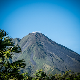 Arenal Volcano by Mike Crosson - Landscapes Mountains & Hills ( sky, no person, nature, computer vision tagging, tree, costa rica, lush, scenic, sun, summer, cr, outdoor, beautiful, 2018, mountain, outdoors, costa rica 2018, wood, volcano, travel, landscape )