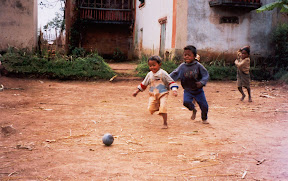 Some kids playing soccer with a homemade ball in a village near Tritriva.