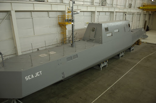 The Advanced Electric Ship Demonstrator (AESD), Sea Jet, funded by the Office of Naval Research (ONR), is a 133-foot vessel located at the Naval Surface Warfare Center Carderock Division, Acoustic Research Detachment in Bayview, Idaho. Sea Jet will operate on Lake Pend Oreille, where it will be used for test and demonstration of various technologies. Among the first technologies tested will be an underwater discharge waterjet from Rolls-Royce Naval Marine, Inc., called AWJ-21, a propulsion concept with the goals of providing increased propulsive effiency, reduced acoustic signature, and improved maneuverability over previous Destroyer Class combatants. (U.S. Navy Photograph by John F. Williams)