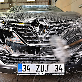 A job well done. by Marcel Cintalan - Transportation Automobiles ( water, automobiles, cleaning, vehicle, service, renault, soap, transportation )