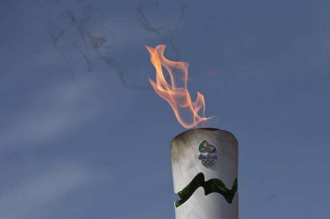 Image of Man Arrested for Failed Attempt Putting the Fire out of Olympic Torch