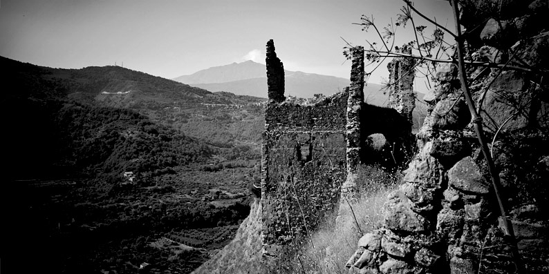 Smoking Etna from castle ruins of Francavilla di Sicilia
