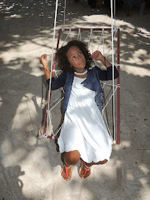Malaika on a beach swing