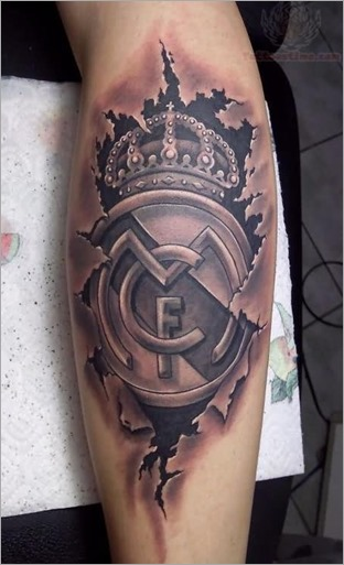 grey-ink-ripped-skin-real-madrid-cf-logo-tattoo