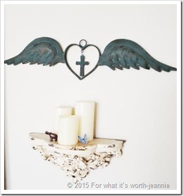 wings and candles on wall