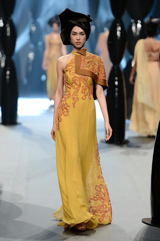 <<A model walks the runway at the Zareena show during Fashion Forward at Madinat Jumeirah on April 13, 2014 in Dubai, United Arab Emirates.>>