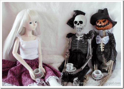 Having Tea with Halloween Skeleton Dolls