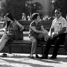 Tired bench  by Max Tikhomirov - People Street & Candids ( massage, bench, black and white, street, outdoors, feet, candid, city, barefoot )