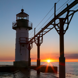 Setting Sun Silhouettes Lighthouse at St. Joseph by Kenneth Keifer - Buildings & Architecture Public & Historical ( setting sun, harbor, silhouette, north pier, landscape, historic, st. joseph, nature, pier, light, evening, maritime, midwest, lighthouse, horizon, lake, seascape, great lakes, dusk, silhouetted, michigan, landmark, catwalk, outer, navigation, sunset, sundown, beacon, flare, nautical )