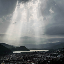 Light over city by Ovidiu Sumănar - Landscapes Cloud Formations ( water, clouds, mountains, sky, trees, light, sun, river, city )