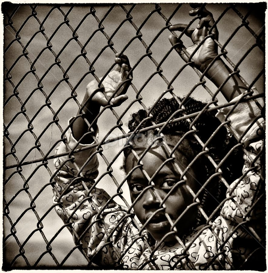 by Marianna Armata - News & Events World Events ( journalism, fence, girl, black and white, gray scale, marianna armata, black, b/w. sepia )