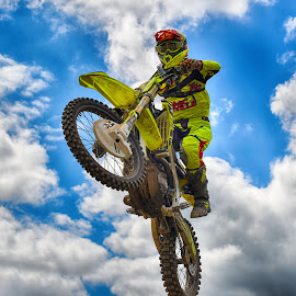 Yellow Fun by Marco Bertamé - Sports & Fitness Motorsports ( clouds, flying, red, motocross, blue, speed, cloudy, grey, air, yellow, high, race, jump, noise )