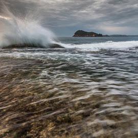 Moving Waters by Geoffrey Wols - Landscapes Waterscapes ( water, splash, sunrise, motion, rocks, island )