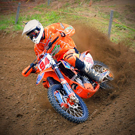 Producing Dust by Marco Bertamé - Sports & Fitness Motorsports ( curve, turn, orange, bike, motocross, dust, clumps, motorcycle, alone, race, outside, competition,  )