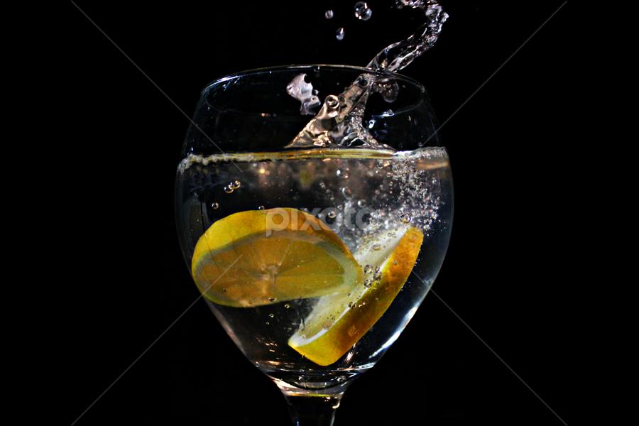 by Dipali S - Food & Drink Fruits & Vegetables ( water, lemon slice, splash, fresh, lemmonade, lemon juice )