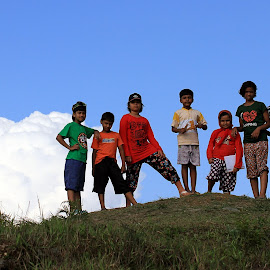 on the top  by Souvik Dey - Babies & Children Children Candids ( clouds, hills, blue sky, colorful, children )