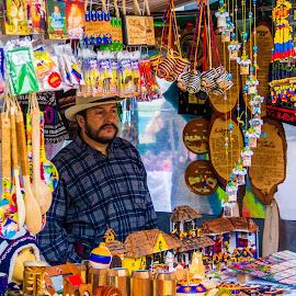 Hopeful Seller  by Vimal Sevak - City,  Street & Park  Markets & Shops ( seller, art, tradition, colombia, street photography )