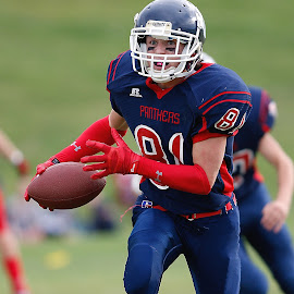 Interception by Keith Johnston - Sports & Fitness American and Canadian football ( field, player, football, ball carrier, action, back, gloves, game, helmet, running, interception )